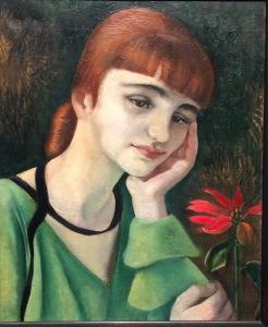 Frau mit roter Blume von Anita Rée